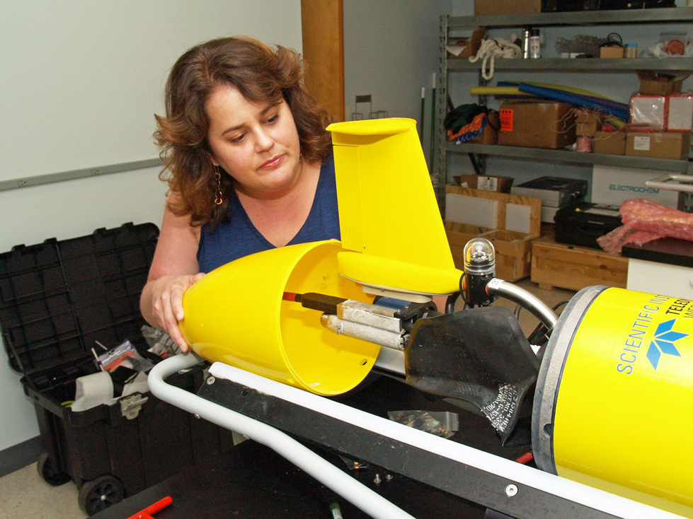 UGA Skidaway Institute of Oceanography researcher Catherine Edwards assembles the tail cone assembly of a glider.